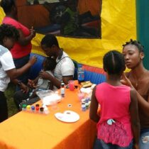 Fun trikes,  cotton candy,  face painting,  children playing,  parents smiling. ...